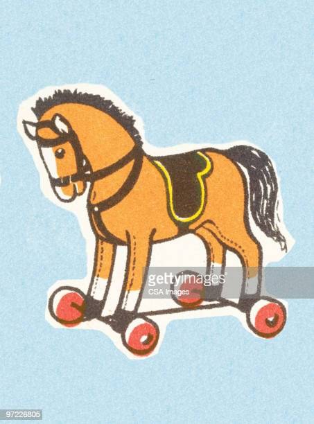 toy horse on wheels - toy stock illustrations