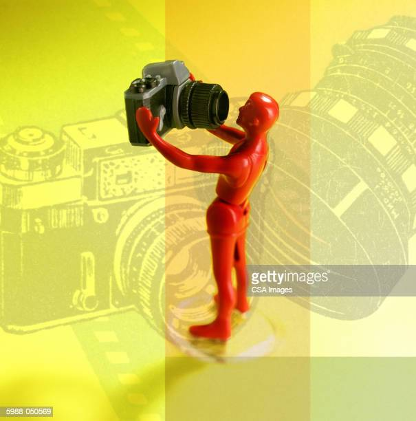 toy man taking self-portrait - camera stand stock illustrations, clip art, cartoons, & icons