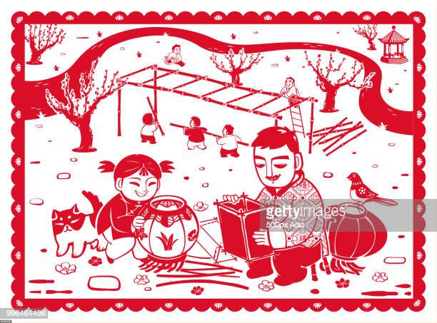 Traditional Chinese paper cutting of father and daughter making Chinese lanterns