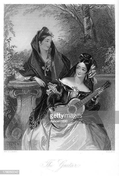 Traditionally Spanish women playing the guitar