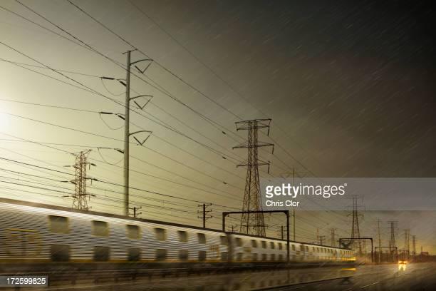 train speeding by power lines - rain stock illustrations