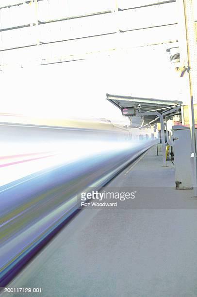 Train speeding past platform