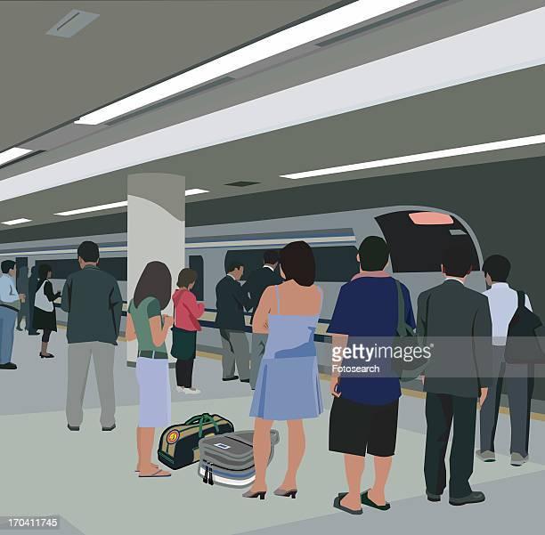 Travelers standing at metro station