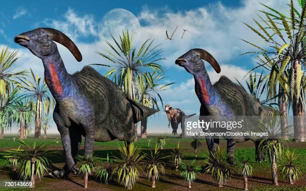 A T-rex chasing a pair of Parasaurolophus dinosaurs.