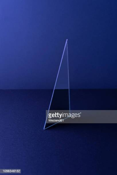illustrations, cliparts, dessins animés et icônes de triangle shaped mirror on dark blue ground, 3d rendering - monochrome image teintée