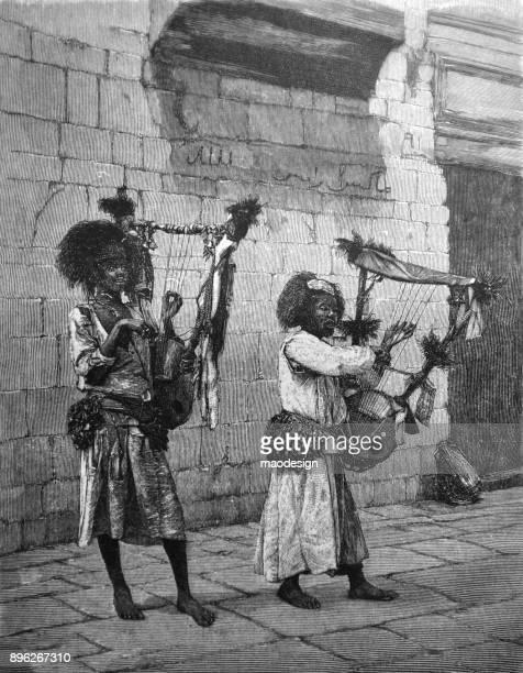 illustrations, cliparts, dessins animés et icônes de deux femmes africaines jouent du groenland dans les rues d'un pays arabe - 1896 - femme africaine