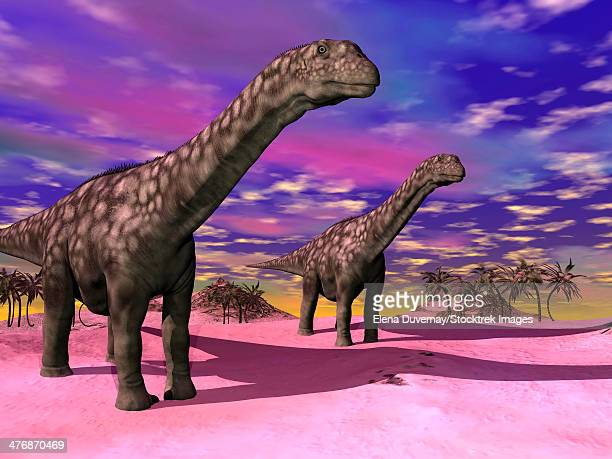 Two Argentinosaurus dinosaurs in a prehistoric landscape with colorful sky.