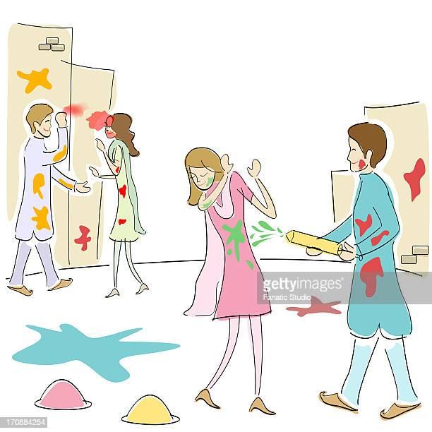 two couples celebrating holi - powder paint stock illustrations