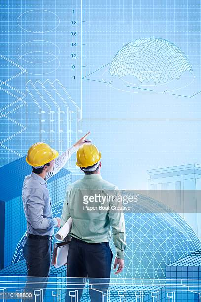 Two engineers looking at a virtual building plan