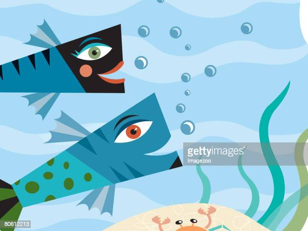 Two fish swimming together near a crab