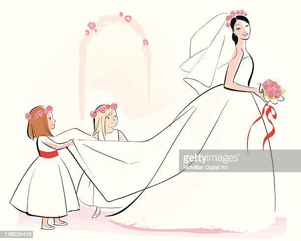 Two flowergirls adjusting bride's train