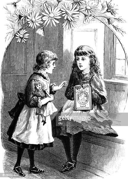 Two girls in living room talking about a book