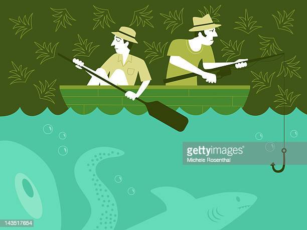 Two men fishing with squid and shark underwater