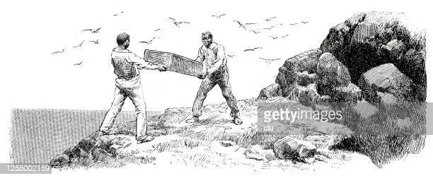 zwei männer heben eine schatzkiste auf der insel - westeuropa stock-grafiken, -clipart, -cartoons und -symbole