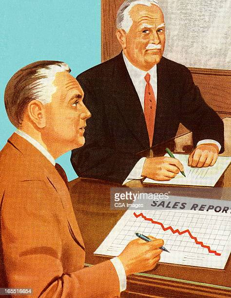 Two Men Looking at a Sales Report