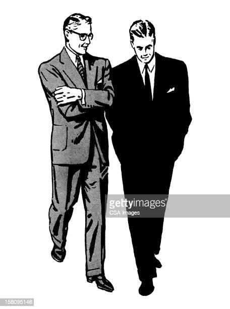 Two Men Walking and Talking