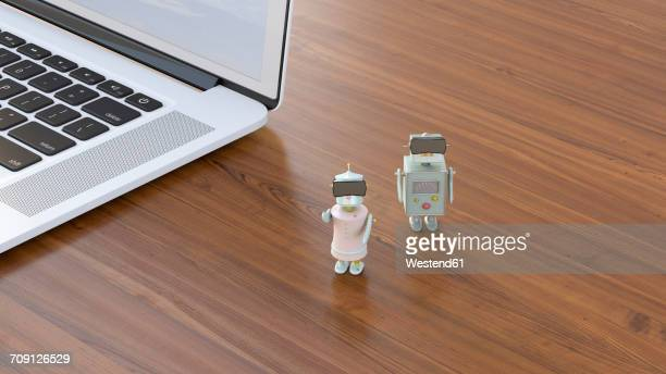 Two robots at laptop wearing virtual reality glasses, 3D rendering
