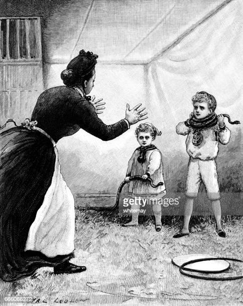 Two Victorian children playing with snakes