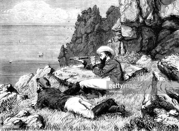 Two Victorian men looking out to sea from a clifftop