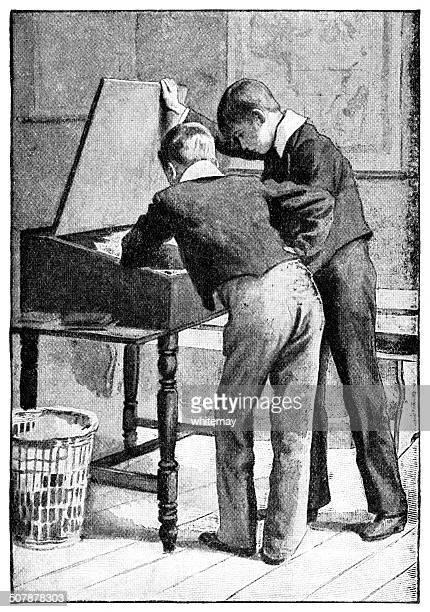 Two Victorian schoolboys looking into a school desk