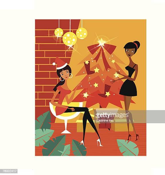 two women decorating a christmas tree - updo点のイラスト素材/クリップアート素材/マンガ素材/アイコン素材