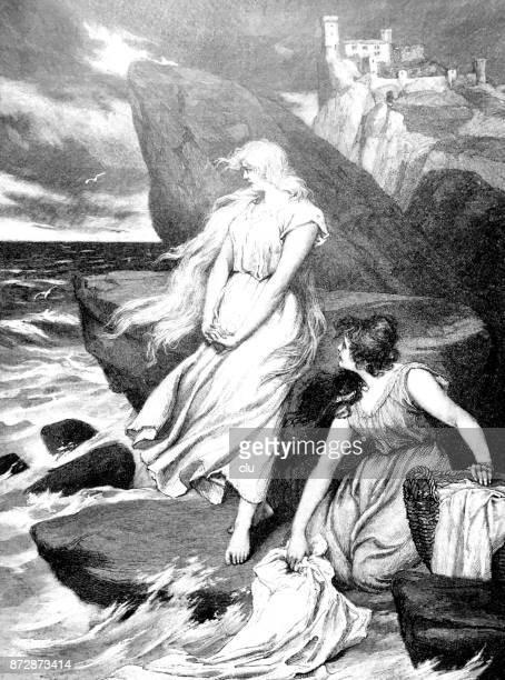 海で洗濯をしている 2 人の女性
