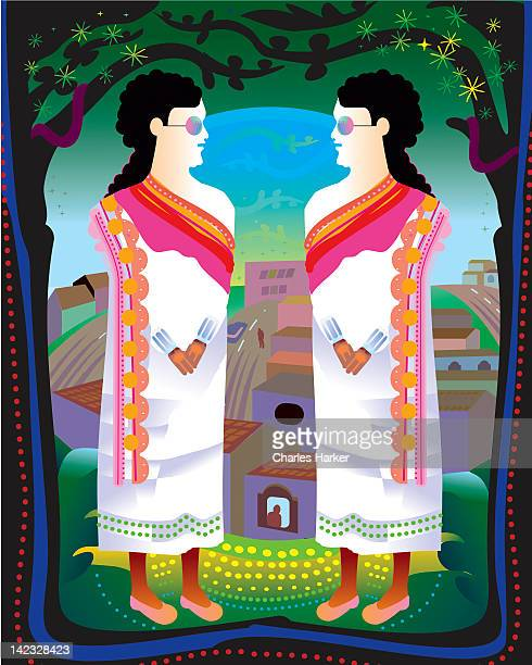 Two women in traditional dress in front of town