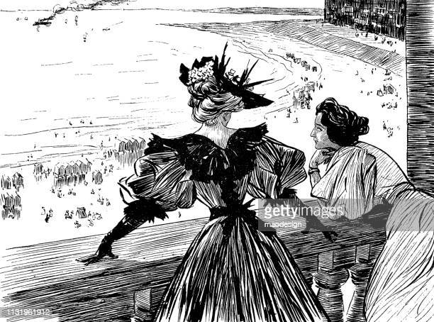 Two women look at the beaches full of tourists - 1896