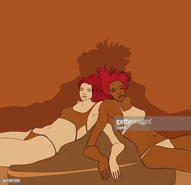 Two Women Lying at the Edge of a Bed