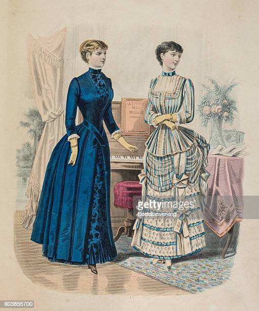 Two women showing layered  blue dresses with queue