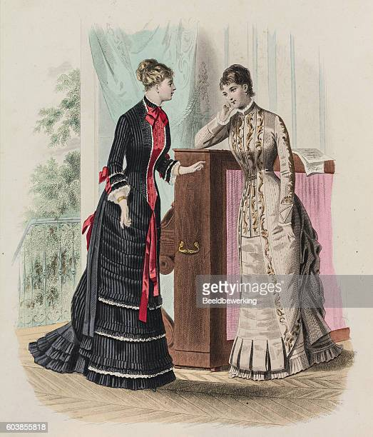 Two women showing layered spanish dresses with train