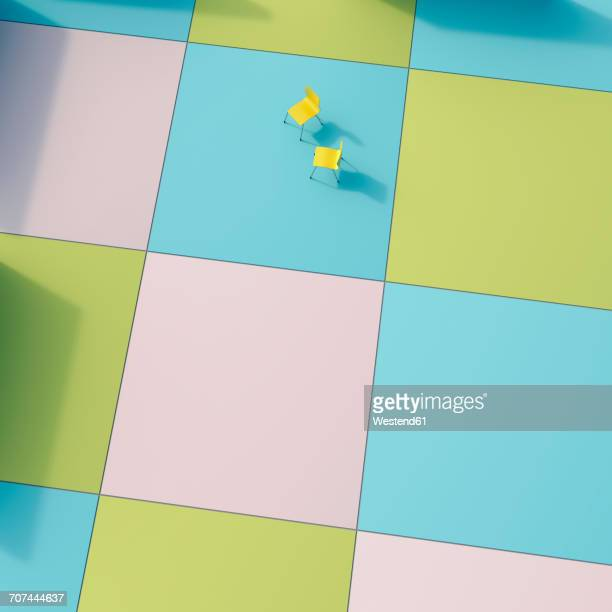 Two yellow chairs on coloured tiles, 3D Rendering