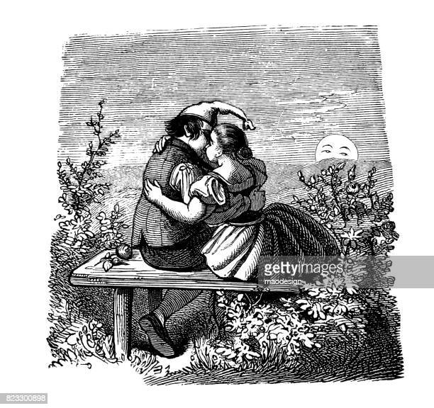 Two young adults kissing on a bench in nature - 1867