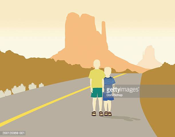 two young boys (4-7) standing in front of desert monument, portrait - dividing line road marking stock illustrations, clip art, cartoons, & icons