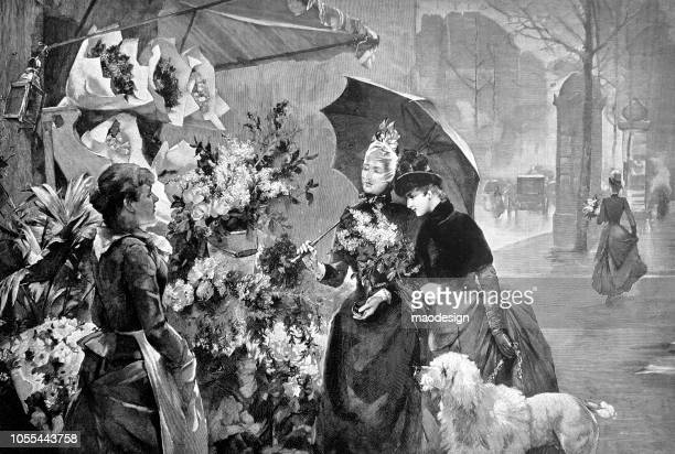 Two young women ask the florist about flowers at a street market - 1888