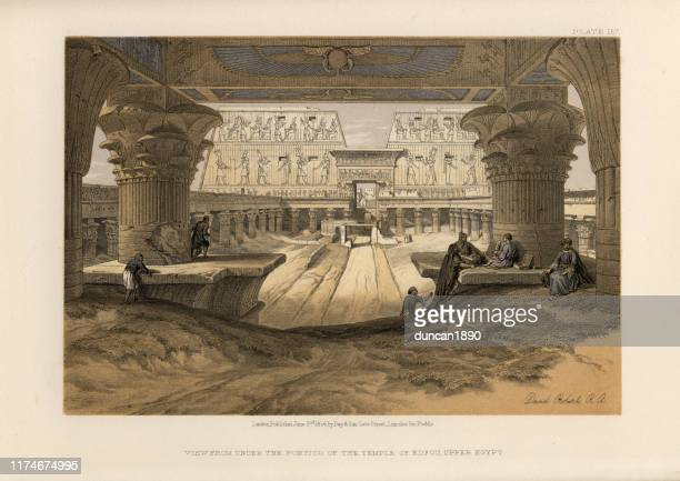 under the portico of the temple of edfu, upper egypt - ancient egyptian culture stock illustrations