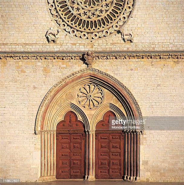 Italy; Umbria; Perugia; San Francesco Upper Basilica. Detail. Front/facade geminous portal/doorway ogival/lancet/pointed arch trilobate/three-lobe...