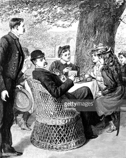 Upper-class Victorian family taking tea in the garden
