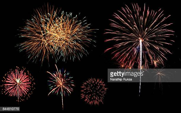 a variety of colorful fireworks isolated on black background - 花火点のイラスト素材/クリップアート素材/マンガ素材/アイコン素材