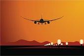 Vector aircraft landing at sunset