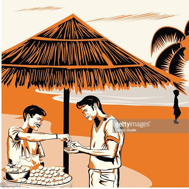 Vendor serving Indian snack panipuri to a man on the beach, India