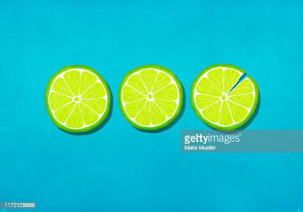 vibrant green lime slices on blue background - individuality stock illustrations