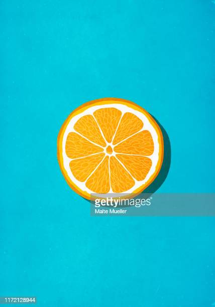 vibrant orange slice against blue background - orange color stock illustrations