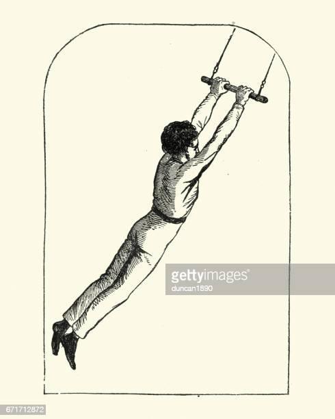 Victorien garçon se balançant sur un trapèze