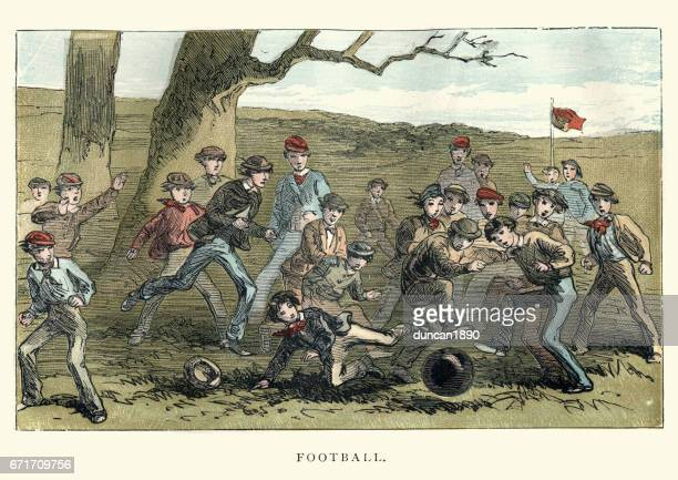 Victorian boys playing a game of football