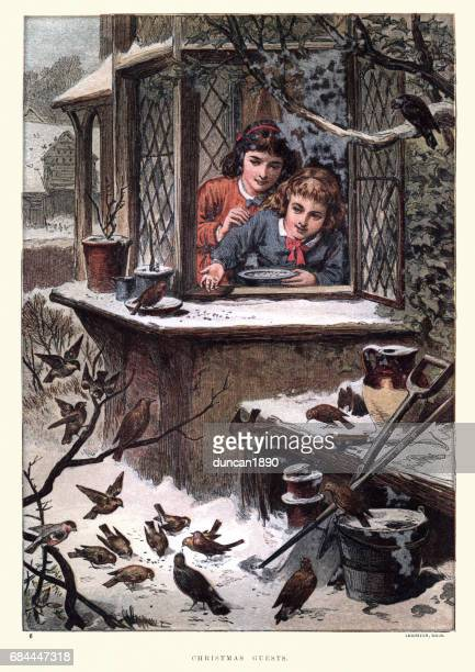 Victorian children feeding the birds at Chistmas, 19th Century