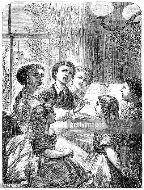 Victorian children singing Christmas carols with their mother