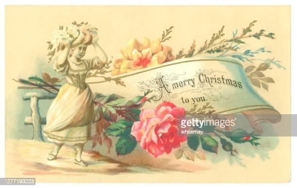 花、巻物と若い女の子、1878年のビクトリア朝のクリスマスカード - 1870~1879年点のイラスト素材/クリップアート素材/マンガ素材/アイコン素材