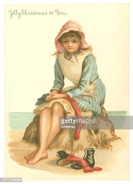 victorian christmas card with girl on beach, 1884 - stockings no shoes stock illustrations