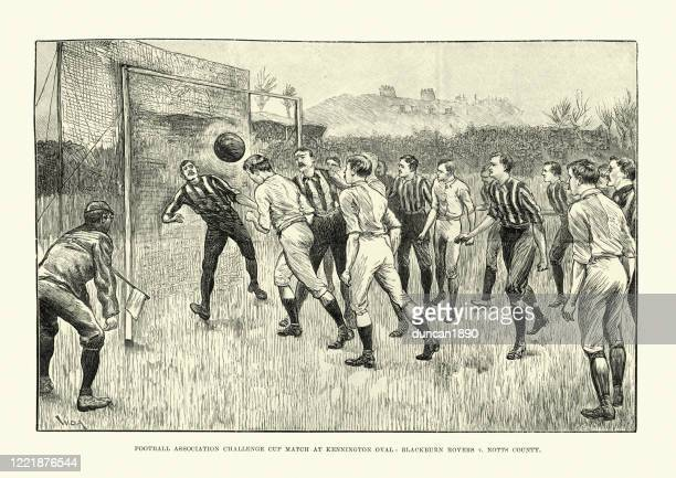 victorian football match between blackburn rovers and notts county, 1891 - heading the ball stock illustrations